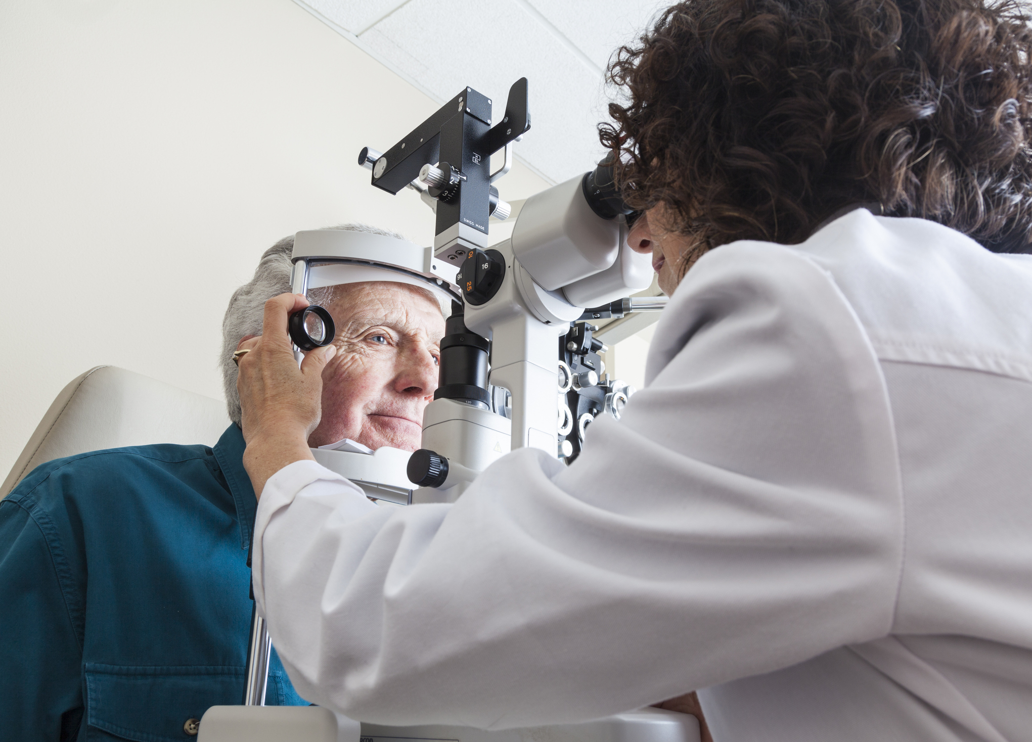 Opthalmologist examining the eyes of a senior patient