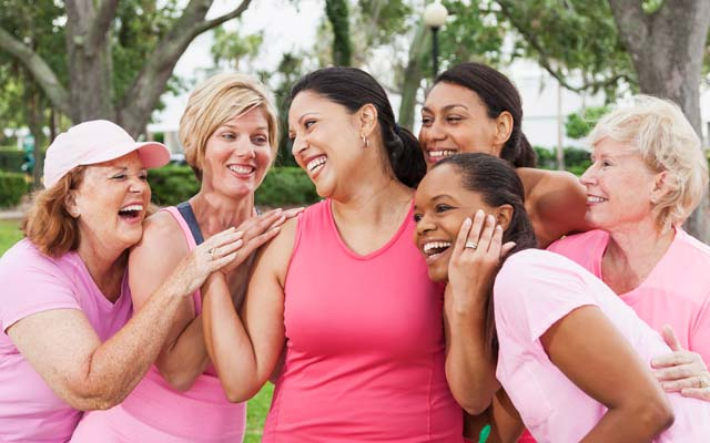 Group of women wearing pink for breast cancer awareness