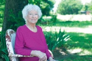 Senior woman seated outside (Letha Walker)